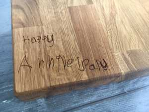 exact copy of handwriting engraved into oak